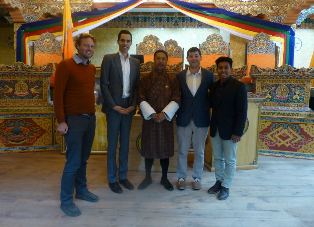 HNMCP Clinic Field Trip to Bhutan. From l. to r., Stephan Sonnenberg '06, Alonzo Emery '10, the Chief Justice, Drew Keneally (a cross registered student from Tufts Fletcher school), and Mushfiqur Chowdhury HDS '18 in the main Supreme Court courtroom.